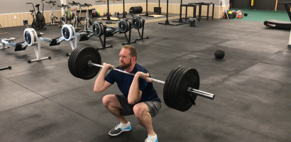 Man Doing Front Squat. Why do gains slow down after you have been working out for a while?